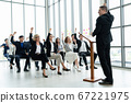 Group of business people meeting in a seminar conference 67221975