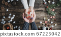 Top view of a couple holding small red giftbox 67223042