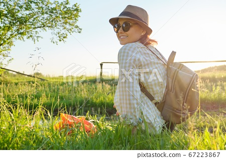Portrait of middle-aged woman relaxing in nature, rustic style 67223867