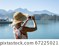 traveling woman take a picture 67225021