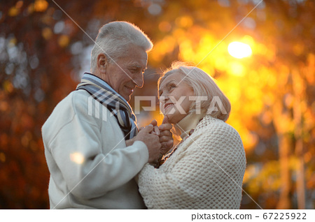 Portrait of beautiful happy senior couple holding hands 67225922