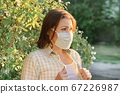 Mature woman in protective medical mask, female outdoor 67226987