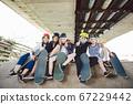 Extreme sport in city. Skateboarding Club for children. Group friends posing on ramp at skatepark. Early adolescence in skate training. Friends skateboarders on street platform for skating on board 67229442