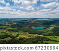 Aerial view on the lake Binningen in Hegau from the Hegau volcanic cone Hohenstoffeln, Germany 67230994