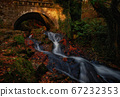 Old stone bridge with mountain stream 67232353