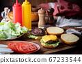 burger on wooden cutting board 67233544