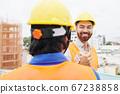 Engineer shaking hand of contractor 67238858