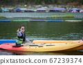 woman sailing kayak boat in water sport pool 67239374