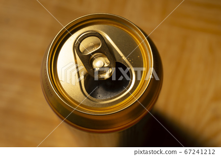 Opened can of beer viewed from above 67241212