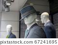 Closeup of grey classic suit for men on manequin 67241695
