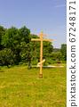 Wooden cross on the territory of the Holy Vvedensky Makaryevsky Zhabyn Monastery, summer 67248171