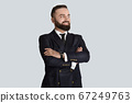 Portrait of happy businessman in formalwear with crossed arms on grey background 67249763