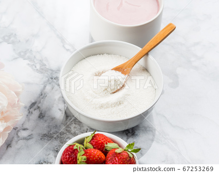 Collagen protein powder in bowl on marble 67253269