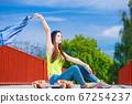Teenage girl skater riding skateboard on street. 67254237