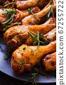 Freshly cooked chicken legs on dark gray plate 67255722