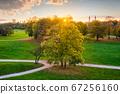 Golden autumn fall October in famous Munich relax place - Englishgarten. Munchen, Bavaria, Germany 67256160