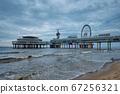 The Scheveningen Pier Strandweg beach in The Hague with Ferris wheel. The Hague, Netherlands 67256321