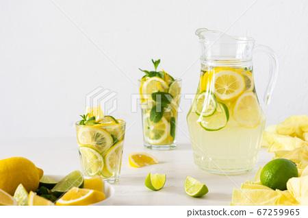 Jug with lemonade and glasses 67259965
