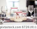 Festive dining table setting 67261811