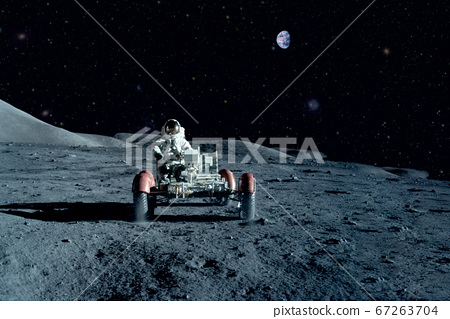 Astronaut near the moon rover on the moon. With 67263704