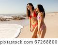 Caucasian women having fun on the beach 67268800