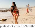 Caucasian women having fun on the beach 67268807