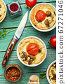 Tart with tomato and mushrooms 67271046