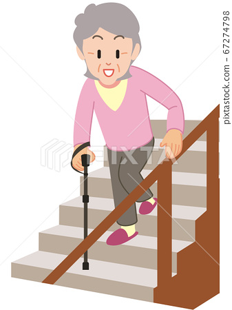 Senior woman walking down the stairs with a cane 67274798