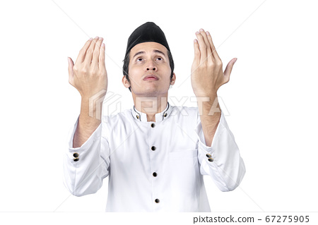 Asian Muslim man standing while raised hands and 67275905
