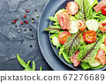 Vegetable salad with salmon 67276689