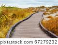 Boardwalk on the beach 67279232