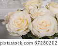Bouquet of white roses flowers close-up in a vase 67280202