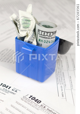 Many american tax blank forms and crumpled hundred 67283561