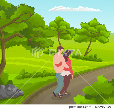 In love couple of young people hugging walking at road near green wood, summer leisure outdoors 67295139