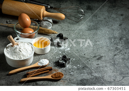 Cooking utensil and recipe for cake making placing on stone plate with copy space 67303451