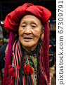 portrait of a woman in a traditional costume of Vietnam 67309791