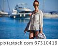 sunny holidays on the Adriatic Sea. Woman, beach, 67310419