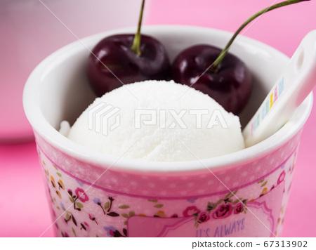 Fresh lemon ice cream scoops with cherries 67313902