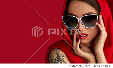 girl in white sunglasses and red headscarf 67317304