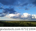 Dark blue and white clouds over the fields and the river, smart 67321004