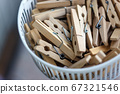 Wooden clothespins in the basket, blur, bright photo. The concept of eco-consumption, the use of 67321546