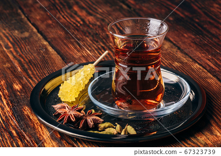 Oriental glass with tea spices on tray 67323739