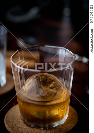 whiskey on the rock with perfect ice ball 67324583