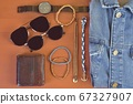 Top view of men accessories. Hipster or modern man concept. Accessories for going for a walk. Male fashion accessories, flat lay on coral pink background. Wallet, bracelets, sunglasses - shades, watch 67327907