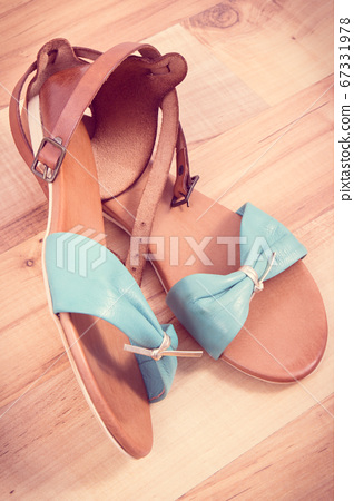 Vintage photo, Pair of womanly leather sandals 67331978