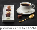 Luxury Chocolate candies in white porcelain plate 67332264