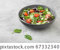Healthy fresh vegetables salad with cucumbers  67332340
