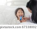 Pediatrician doctor examining little girl. 67338002