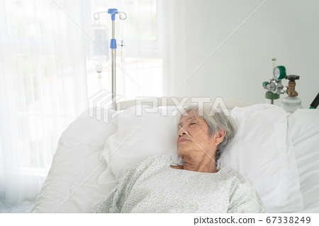 close up of patient grandfather in hospital bed 67338249