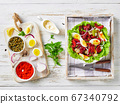 baby octopus salad with eggs, onion, lettuce 67340792